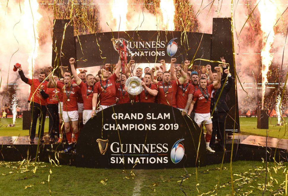 Welsh Rugby TEam celebrating winning the Grand Slam 2019 amongst rain, champagne and fireworks