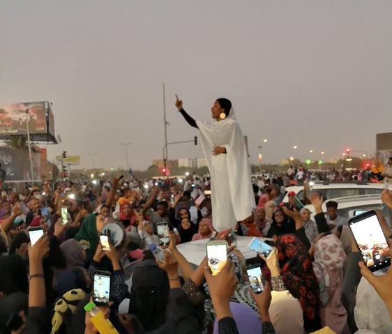 Woman preaching during the unrest in Sudan