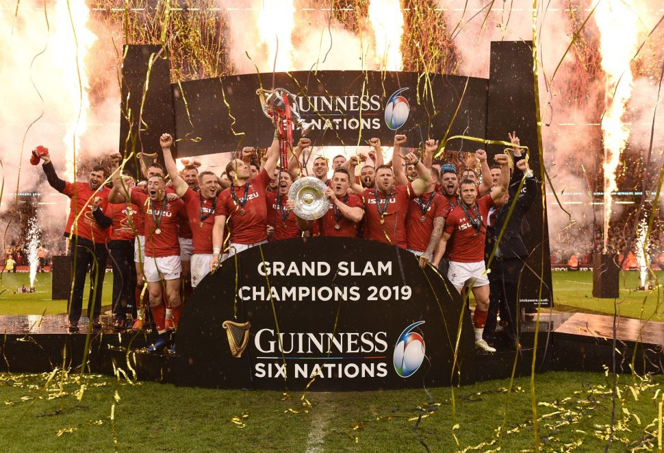 Welsh Rugby TEam celebrating winning the Grand Slam 2019 amongst rain, champagne and fireworks